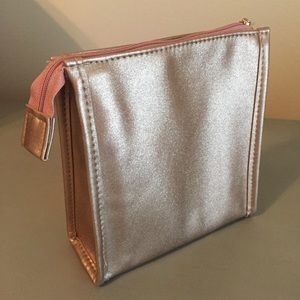 New! Rose gold metallic zippered makeup bag. NWOT